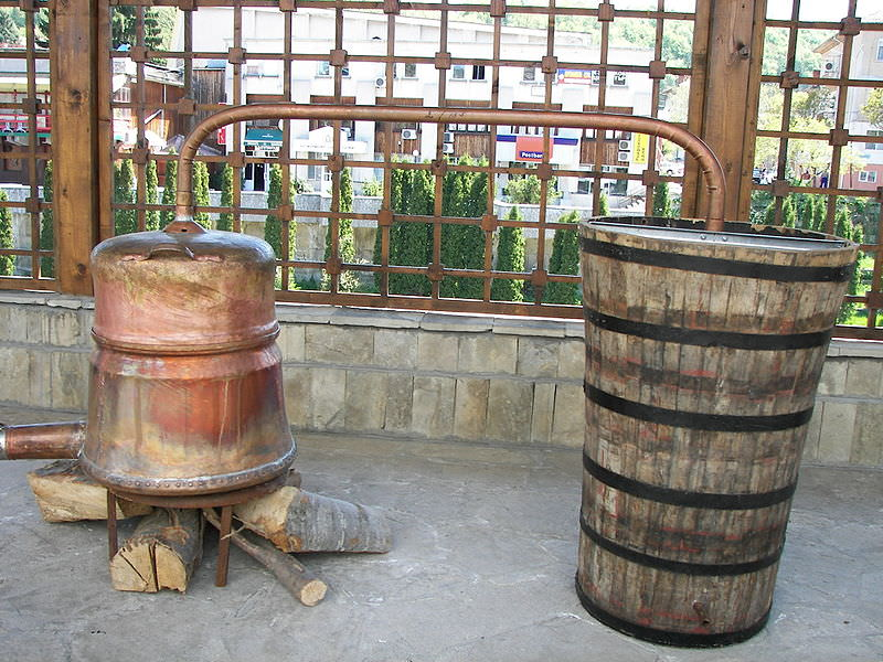 Rakija Home Distillery with a copper kettle and pipe to a wooden barrel