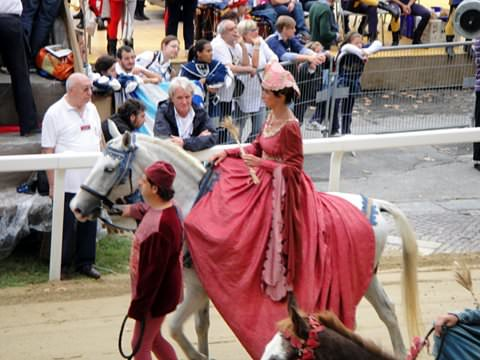 Paraders from each district of Asti are costumed and represent a historic theme