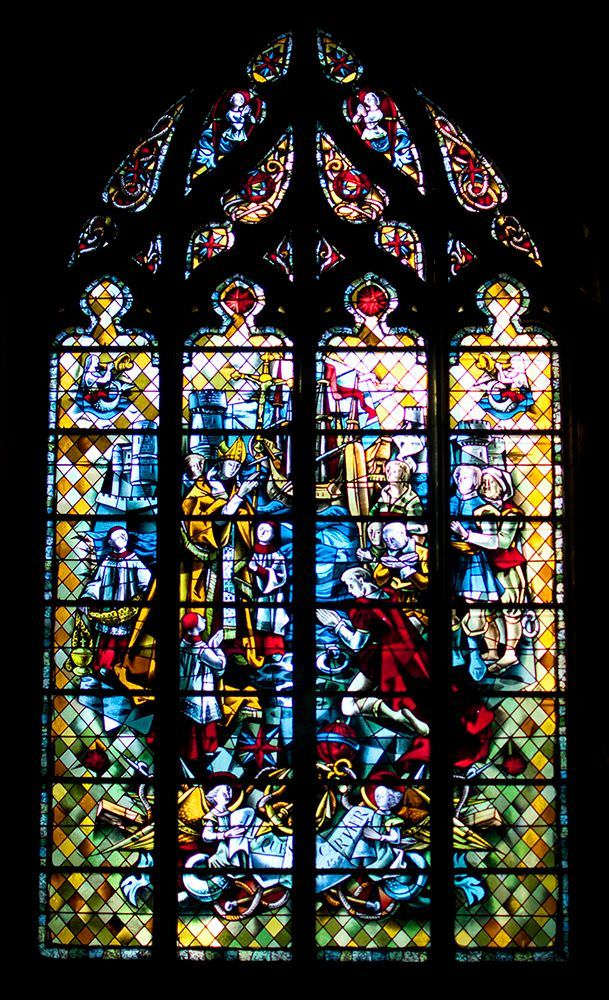 The magnificent stained glass window that shows the bishop blessing Jacques Cartier before he claimed for France what was to become Canada