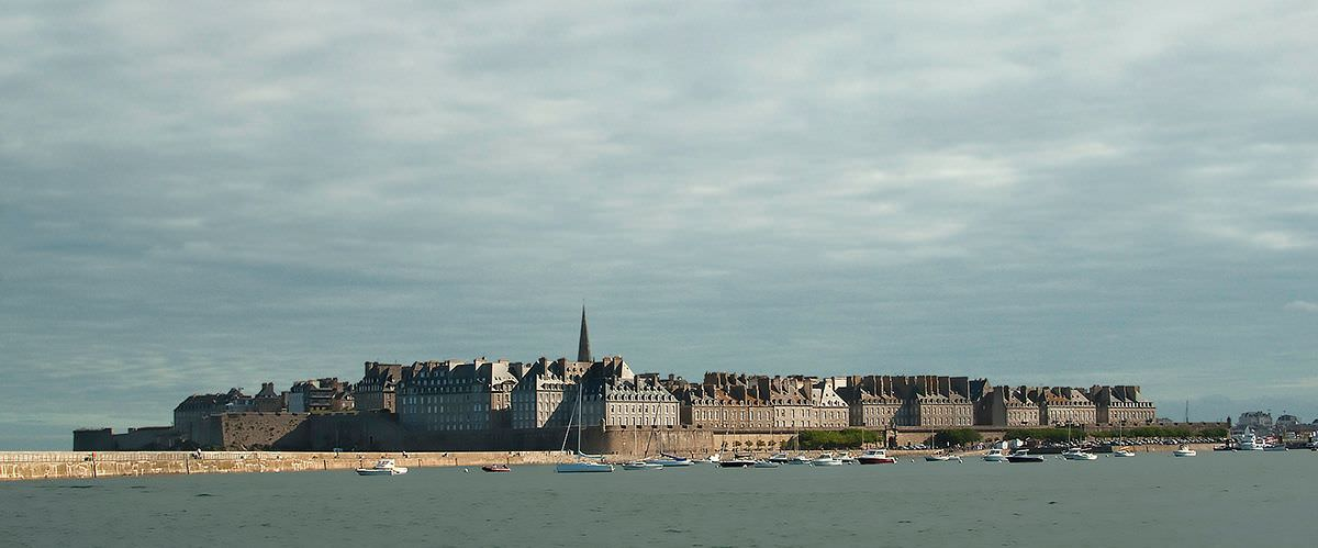 Sun lights up the old town from the early morning Dinard-St-Malo ferry