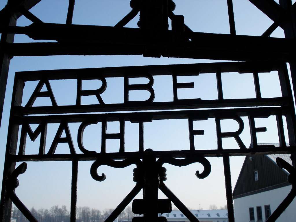 """The notorious gate with the inscription """"Arbeit Macht Frei"""" (Work sets you free) in the Dachau Nazi concentration camp in Dachau, Germany."""