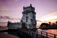 tower of Belem in Lisbon at sunset with stunning purple sky in the background