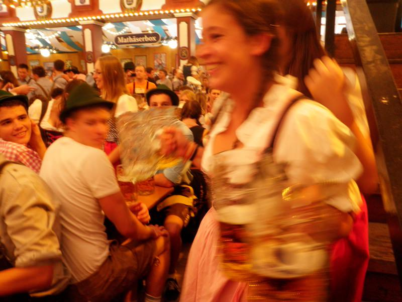 Waitresses carry up to ten-steins at a time