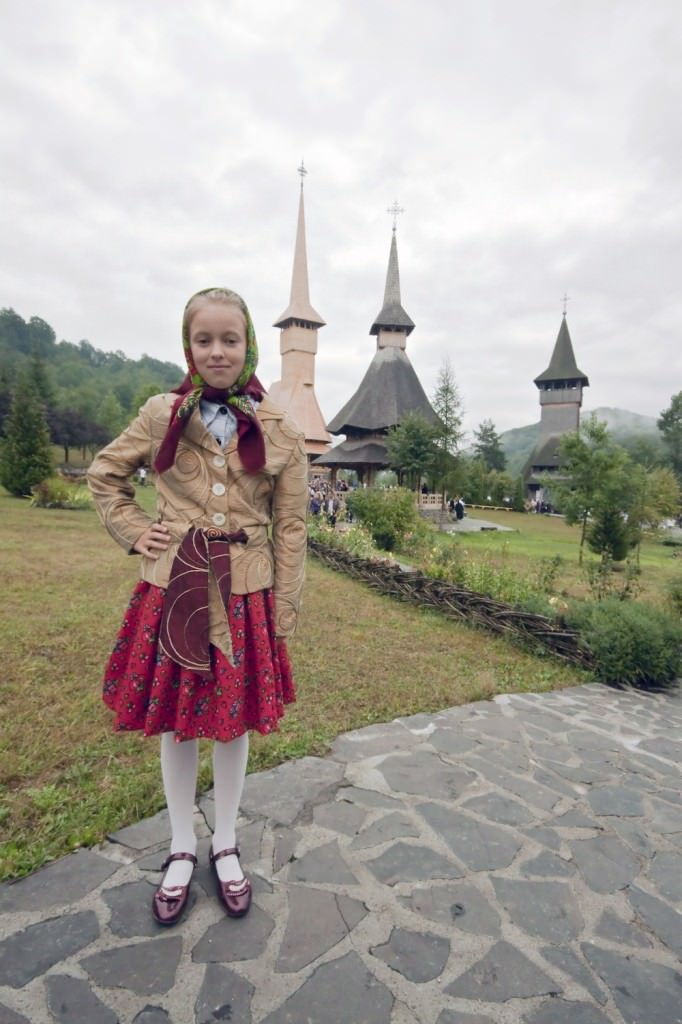 Young girl with Maramures in the background