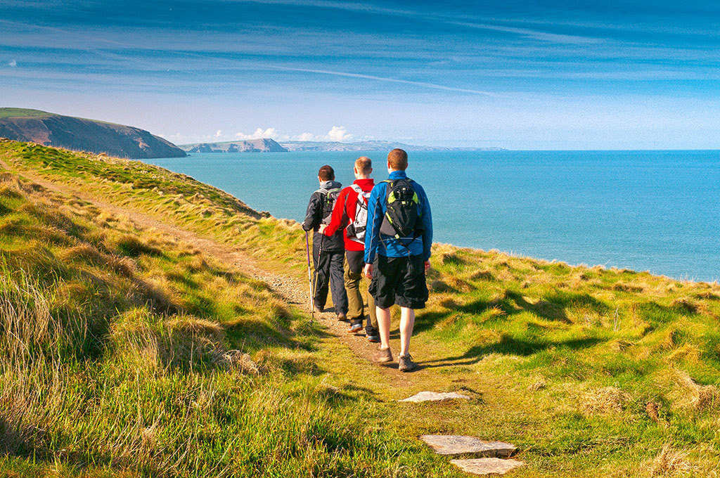 Walkers on Pembrokeshire Wales Coast Path, Ceibwr Photo © Crown copyright (2012) Visit Wales