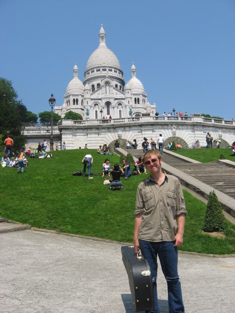 Nick below Sacre Coeur after a day of playing for money