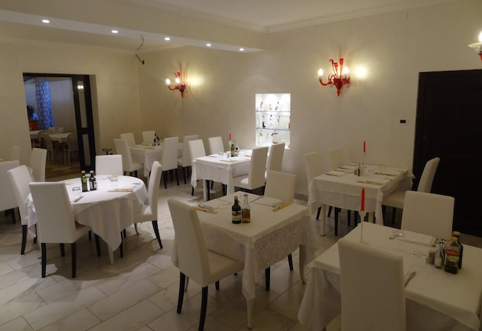 The sleekest of the four dining rooms at Ristorante Medioevo di Rosalina