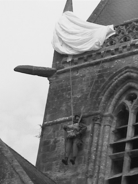 St Mere Eglise parachutist caught on church roof