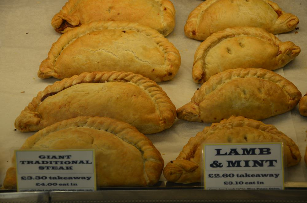 English pasties are giant half-folded crescents of thick, buttery pastry folded around hot, steaming fillings.