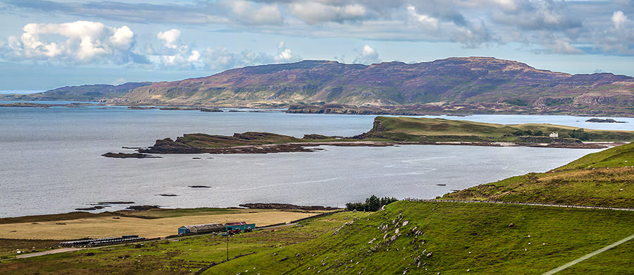 The Isle of Inchkenneth with Ulva behind painted purple by the heather. Taken from high in Ardmeanagh, Mull.