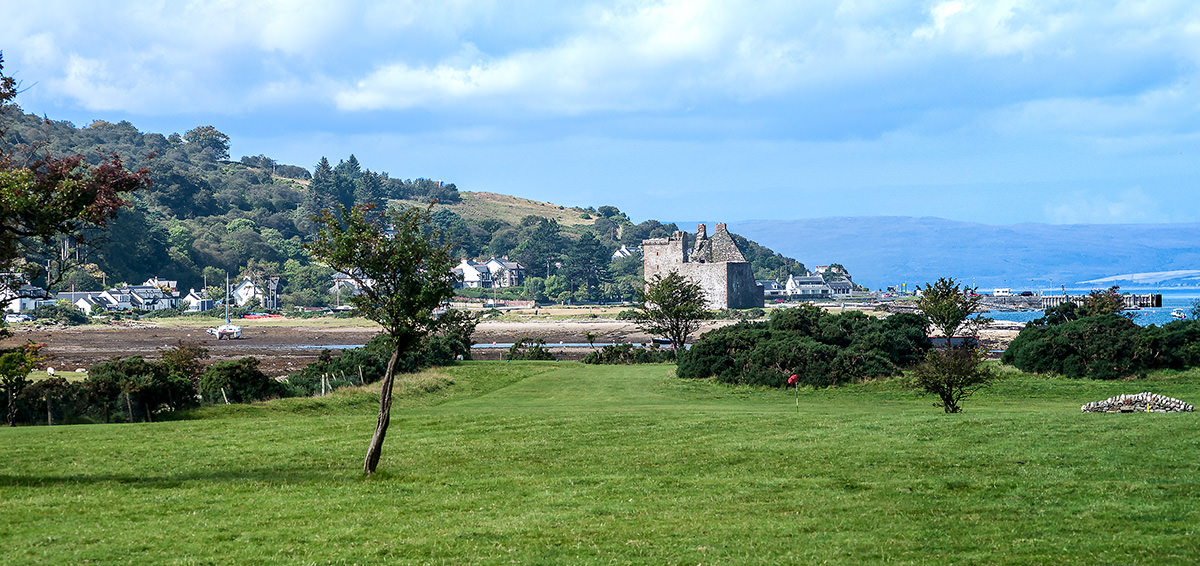 The town and castle of Lochranza in the northwest of Arran. Kintyre is across the Sound of Kilbrannan in the blue distance.