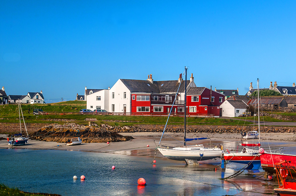 The harbour of tiny Scarinish, the main village of Tiree, with one of the two hotels.
