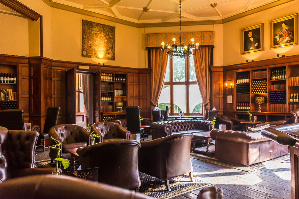 The castle's hallways and lounges are regally outfitted like a baronial mansion