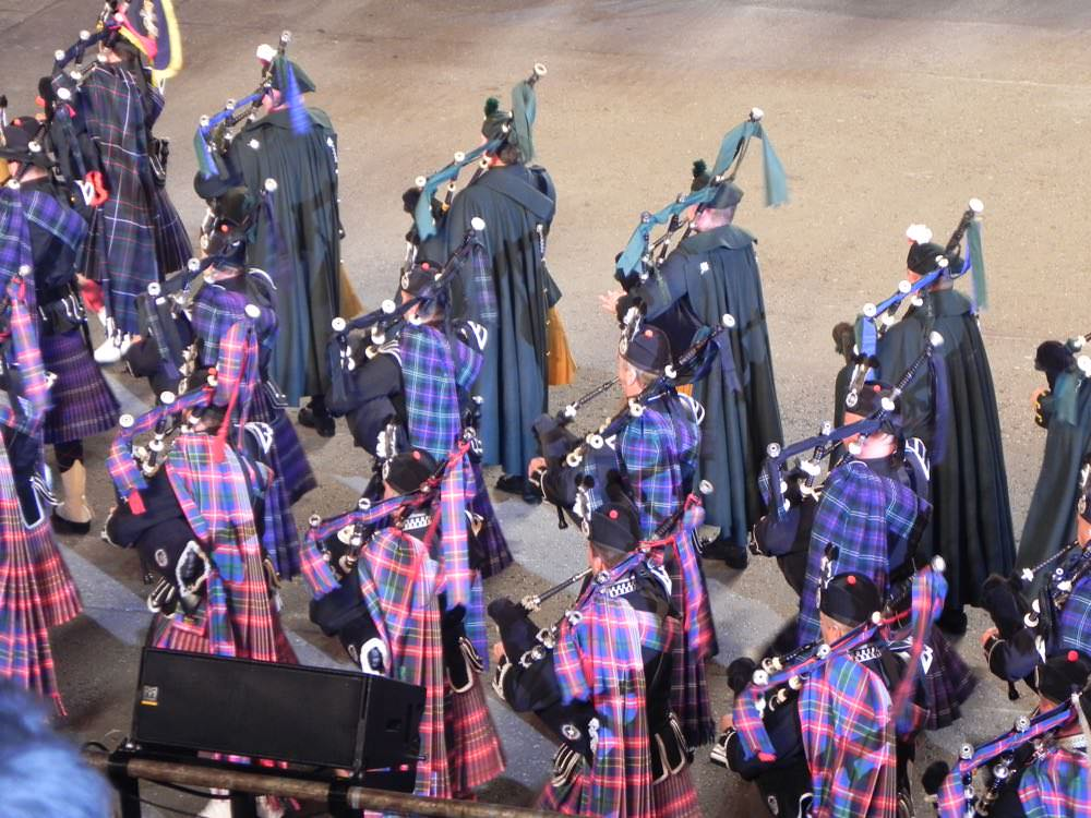 Beautifully clad in tartans, these pipers march in unison at the Edinburgh Tattoo