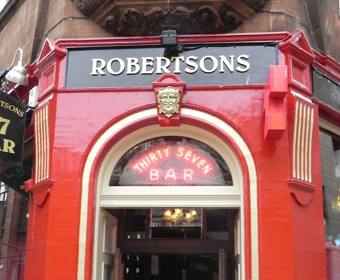 The Green Man face over the entrance to Robertsons