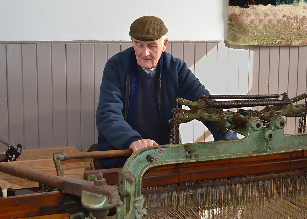 The pedal loom demonstrates the weaving process. It clicks and clacks as the weaver pedals and takes about thirteen hours to finish a complete bolt. Courtesy: Harris Tweed and Knitwear