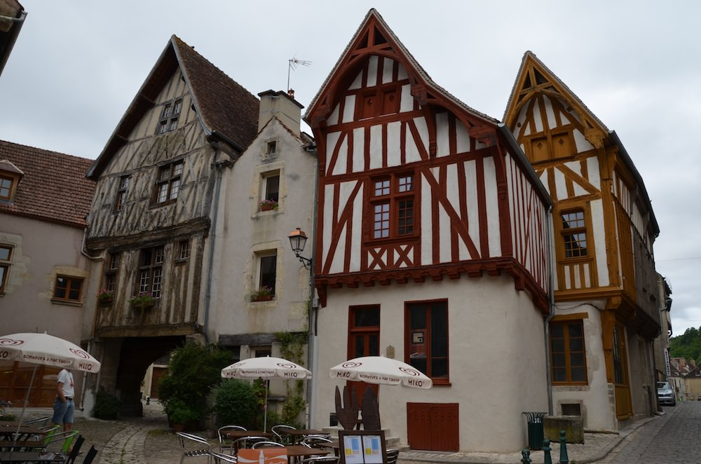Noyers-sur-Serein has numerous well maintained 15th century houses, their crooked walls inset with stained cross beams and filled in with white painted plaster