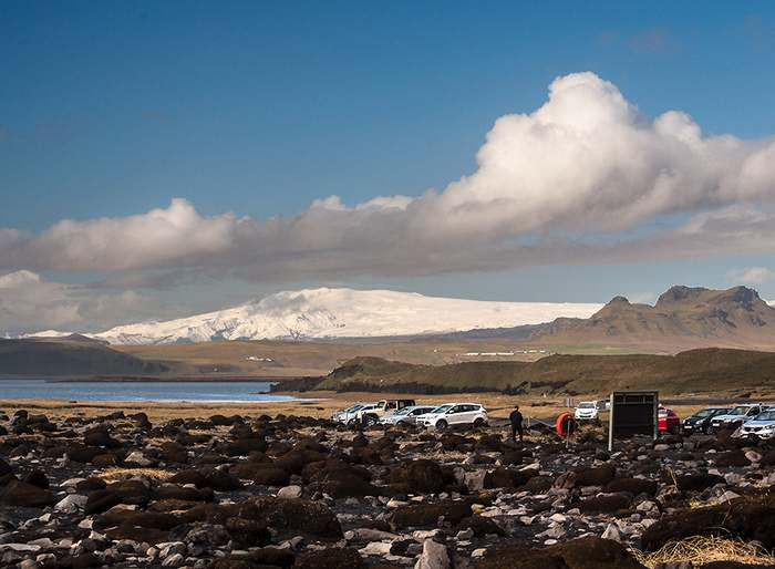 The icecap of Myrdalsjökull, Iceland's fourth largest glacier, as seen from the shore near Vik. Katla, an active volcano rumbles continuously beneath the ice. Several glacial snouts radiate from the main glacier.