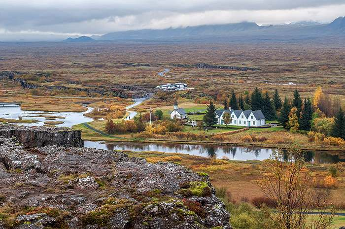 The wide and flat rift valley at Pingvellir, north of the lake, is riven by deep fissures running north-south. The first church was consecrated here in 1000CE and the present church was built in 1859.