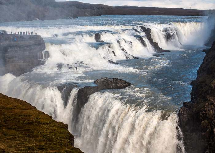 Gullfoss or Golden waterfall on the Hvita River drops 105 feet (32m) in two thunderous falls into a deep gorge. It is fed by Iceland's second largest glacier, Langjökull.