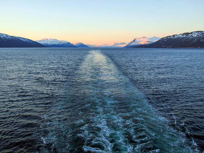 Steaming through the ocean toward Tromsø, far north of the Arctic Circle