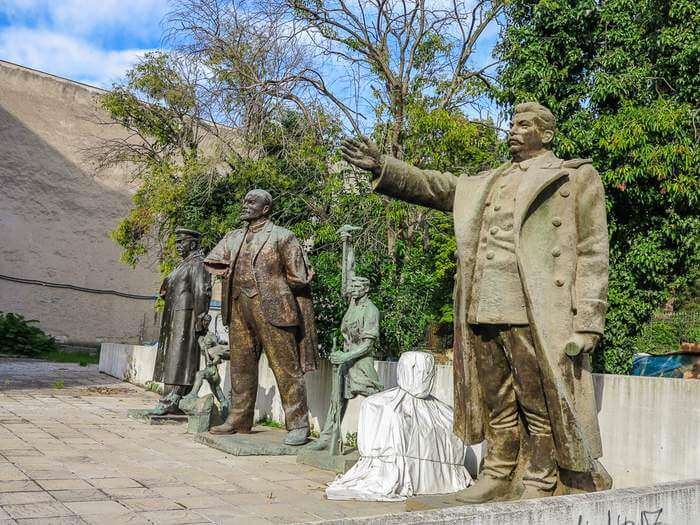 statues still waiting to be restored in Tirana, Albania