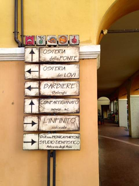 Street signs in Brisighella, Italy