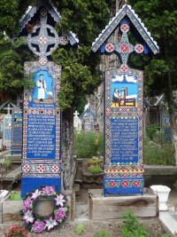 some grave markers describe a happy home life at the Romanian cemetery