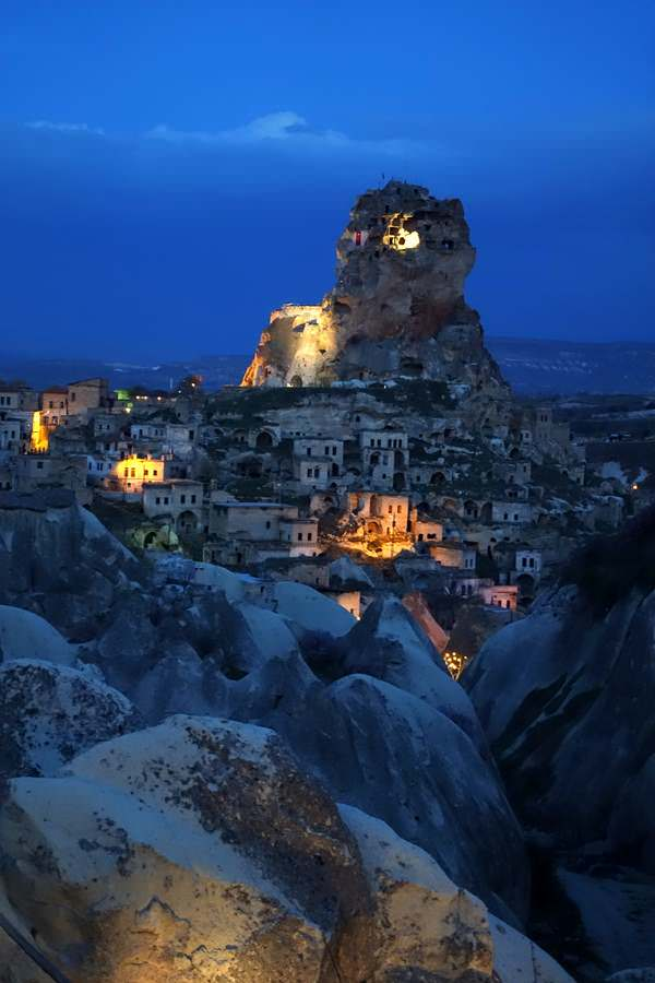 Uchisar Castle at dusk in Cappadocia is one of many Turkish delights
