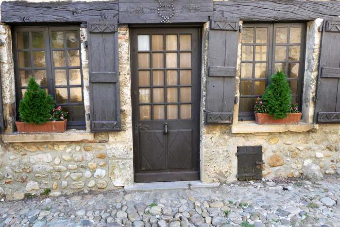 Doors and windows dressed with flowers in Perouges