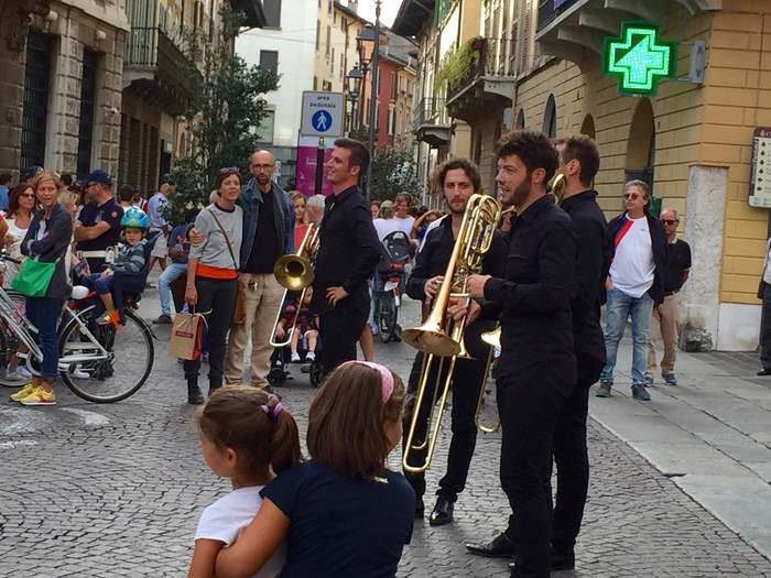 An impromptu brass band in a city piazza, part of the Brescia Opera Festival