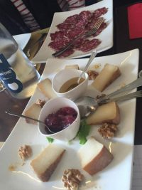 Local salumi and cheeses at La Vineria showcasing Brescia Food