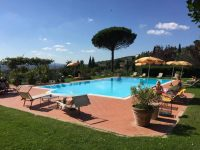 The view to and beyond the pool at Il Falconiere