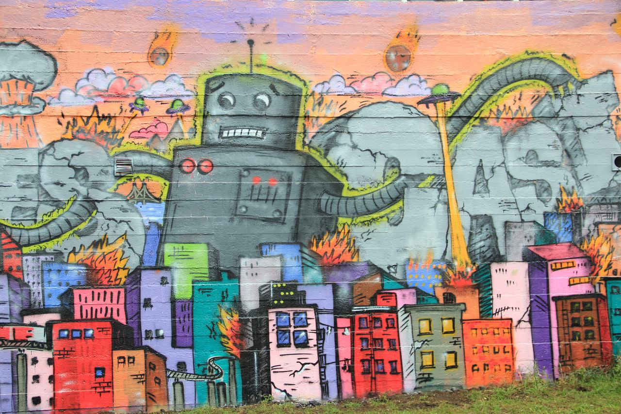 Street art in Iceland showing giant robots and small colorful houses