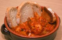 Tuscan food in Livorno- Cacciucco tomatoe-y fish soup with bread