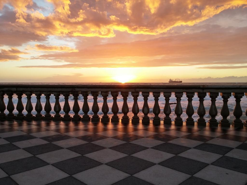Sunset over elegant balcony - Port Livorno is known as the new Venice of Italy