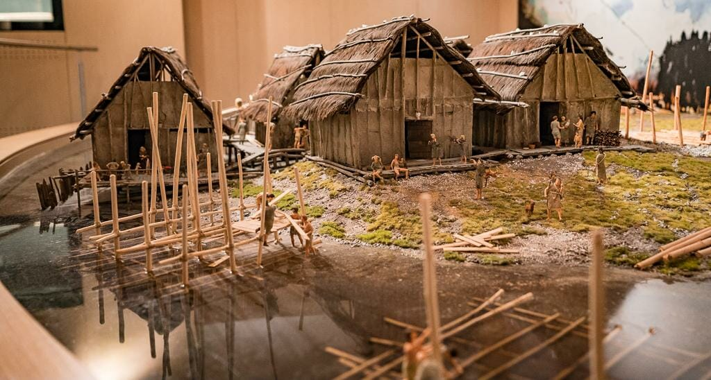 Model depicting daily life in Pile Dwelling Settlement - Prehistoric Pile Dwellings around the Alps Museum in Fiavé Trentino Italy