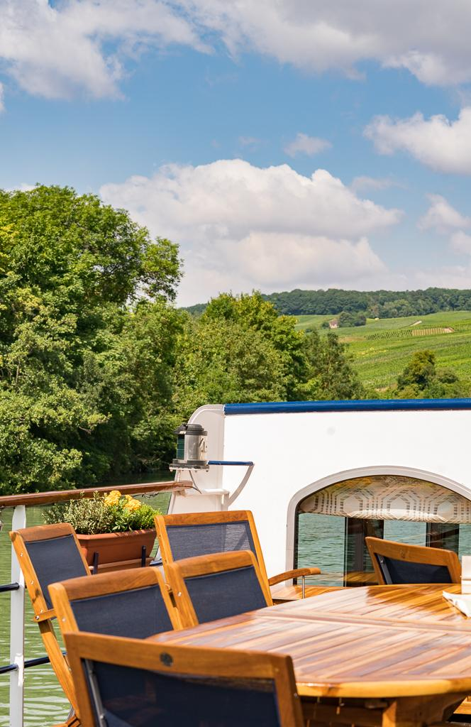 Inviting Sun Deck on board of the Panache European Waterways | Luxury Barge Cruises in France