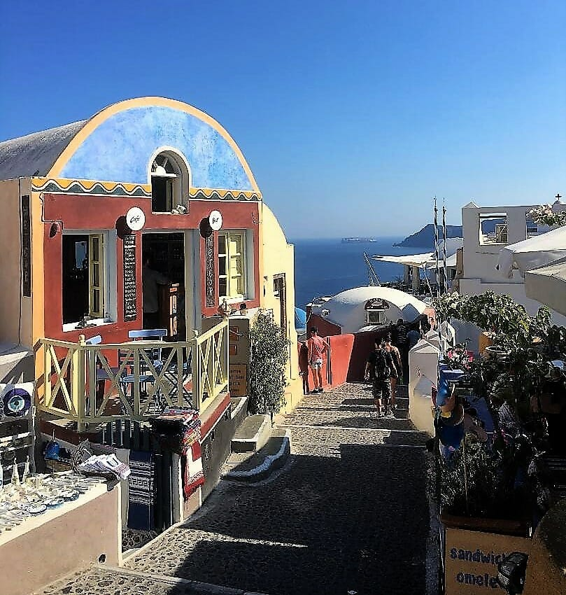 Santorini Itinerary, narrow pedestrian street with hill top Ocean View in Fira