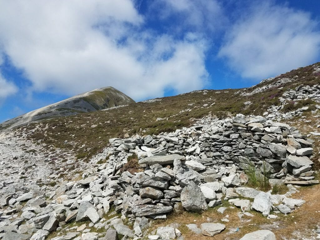 A beautiful view of the rocky side as we ascend on our Croagh Patrick Hike