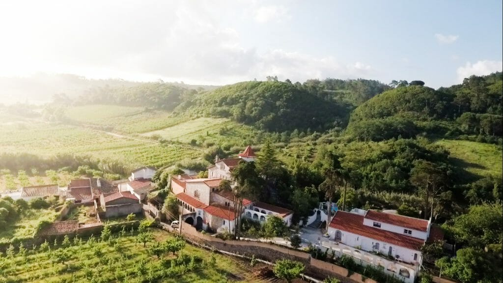 View over Buddha Retreat in Portugal in lush green hills