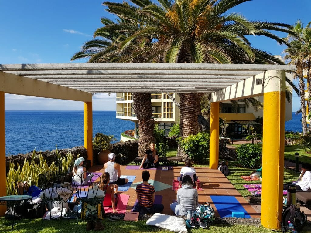 people doing yoga on terrace overlooking ocean in Madeira Portugal