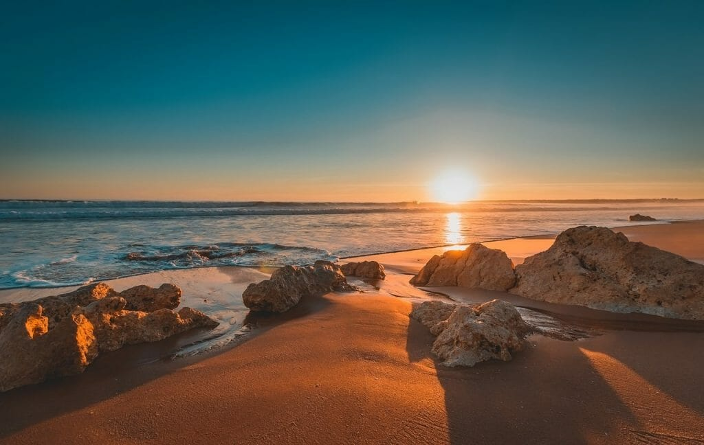 Beach with Rocks in Portugal at Sunset