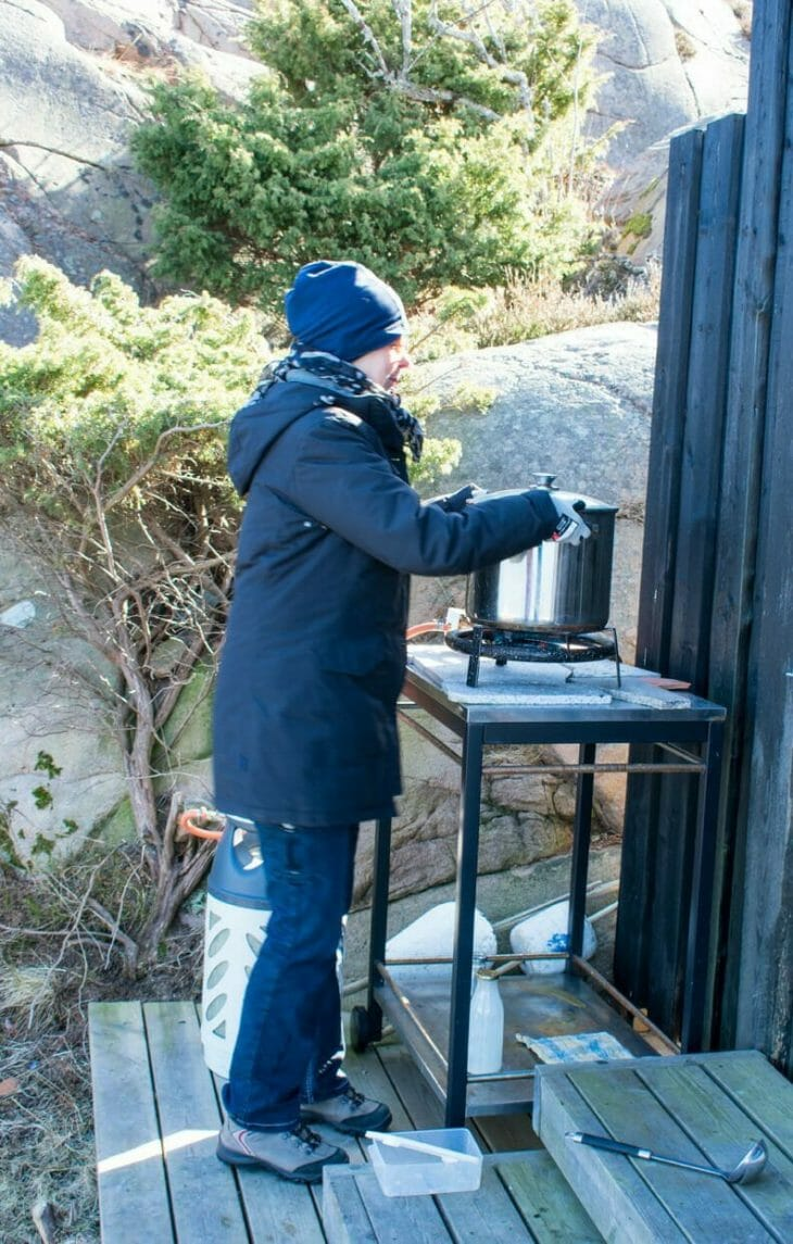 Woman cooking outside in Sweden