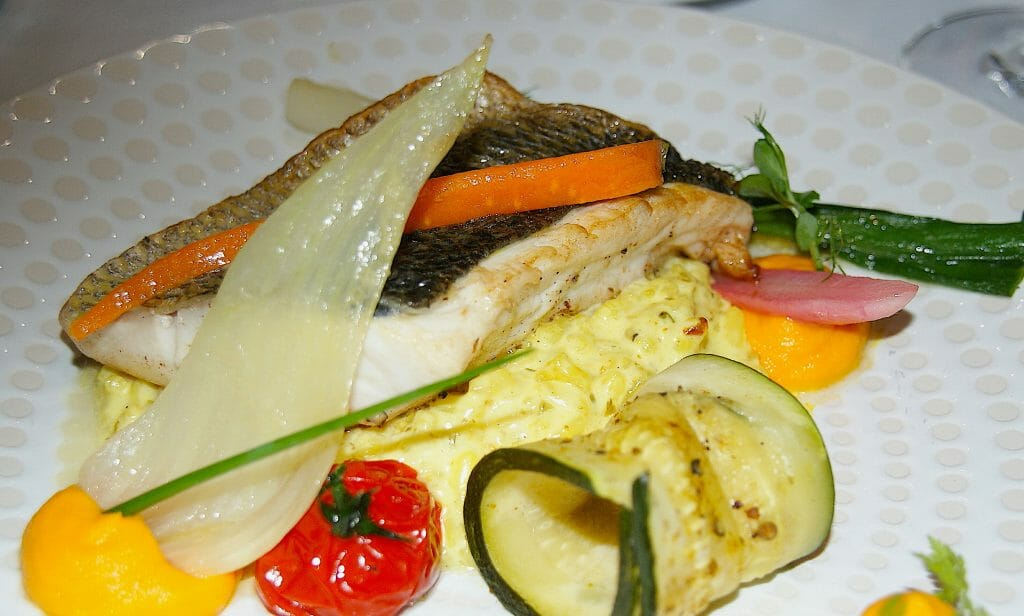 Sea bass dish with colorful vegetables