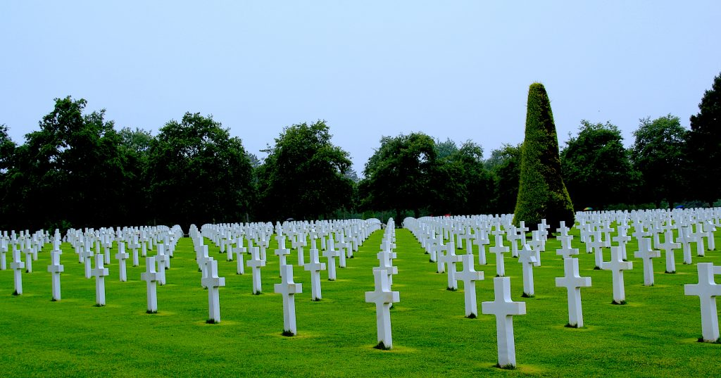 Rows of white crosses of fallen soldiers at the American Cemetery