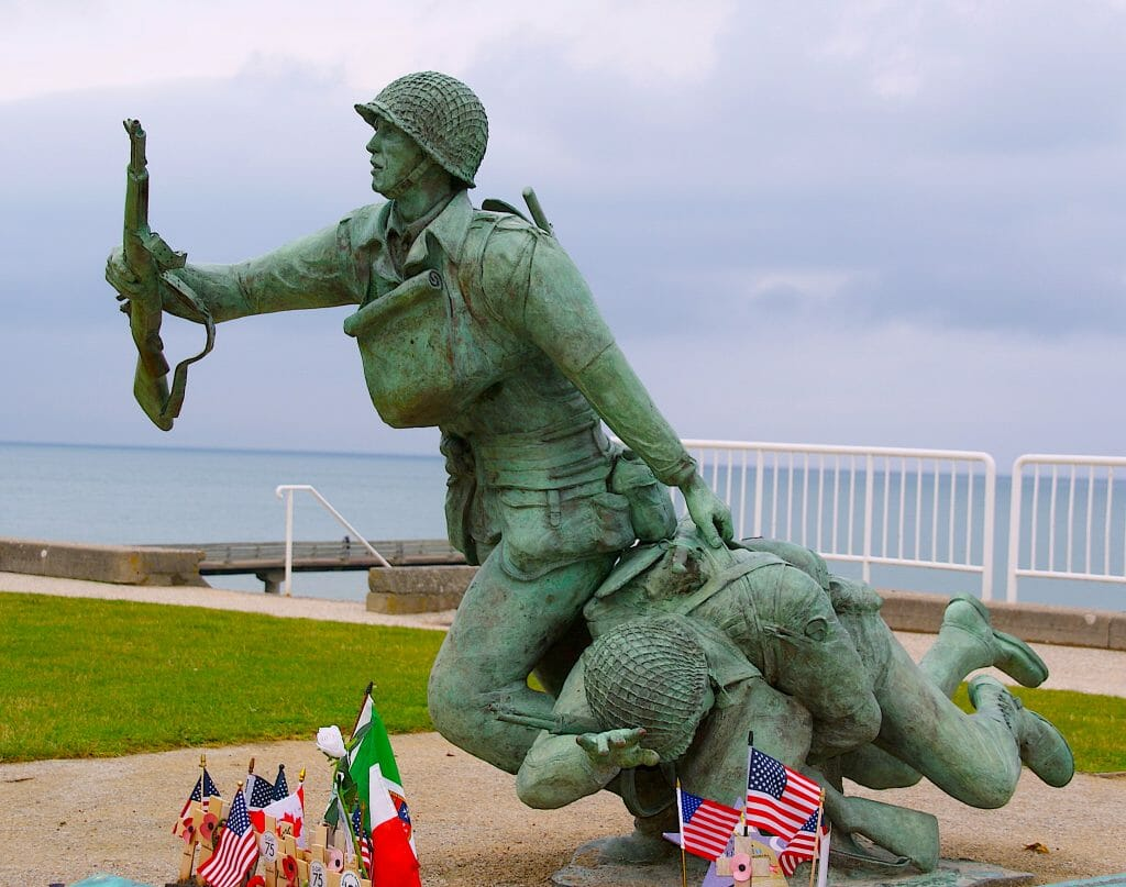 Omaha Beach Statue - Brass Running soldier carrying an injured soldier and a rifle