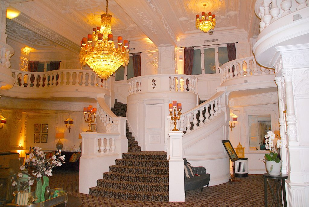 St. Ermin's front lobby, beautiful double staircase with a chandelier overhead