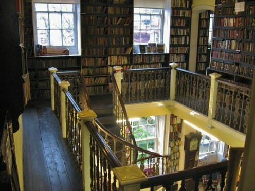 The top floor of the Bromley House Library with a peak down into the main floor