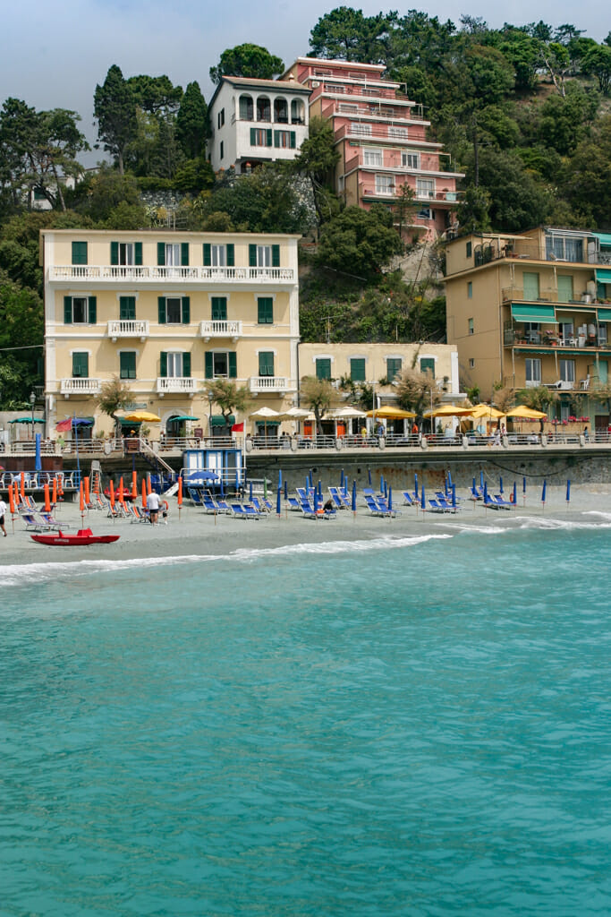 The best beach in Cinque Terre is at Monterosso Al Mare. Crystal clear azure water washes up on the pebbly coast